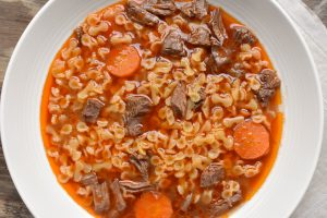 Brodo di carne (beef soup) with farfalline pasta