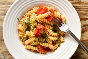 Fusilli pasta 'con pomodorini e basilico' (with cherry tomatoes and basil)