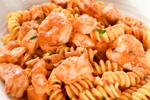 Fussili pasta with salmon and baby prawns (shrimp)