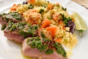 Herbed lamb backstraps with roast vegetable cous cous