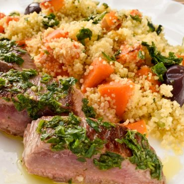 Herbed lamb backstraps with roast vegetable couscous