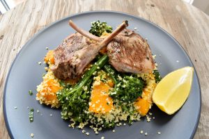 Lamb 'a scottadito' (cutlets) served with roasted pumpkin (squash) and broccolini couscous