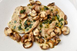 Veal scaloppine 'ai funghi' (of mushrooms)