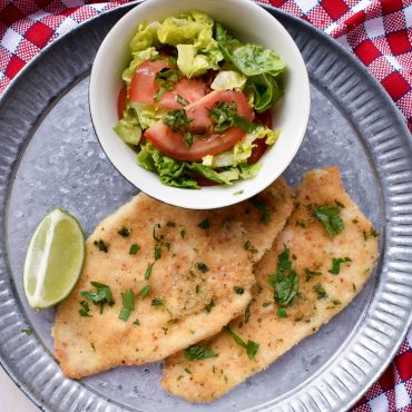 Oven-baked herbed chicken 'cotoletta' (crumbed)
