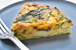 Creamed pumpkin, potato and baby spinach frittata