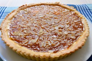 Apricot jam and flaked almond tart