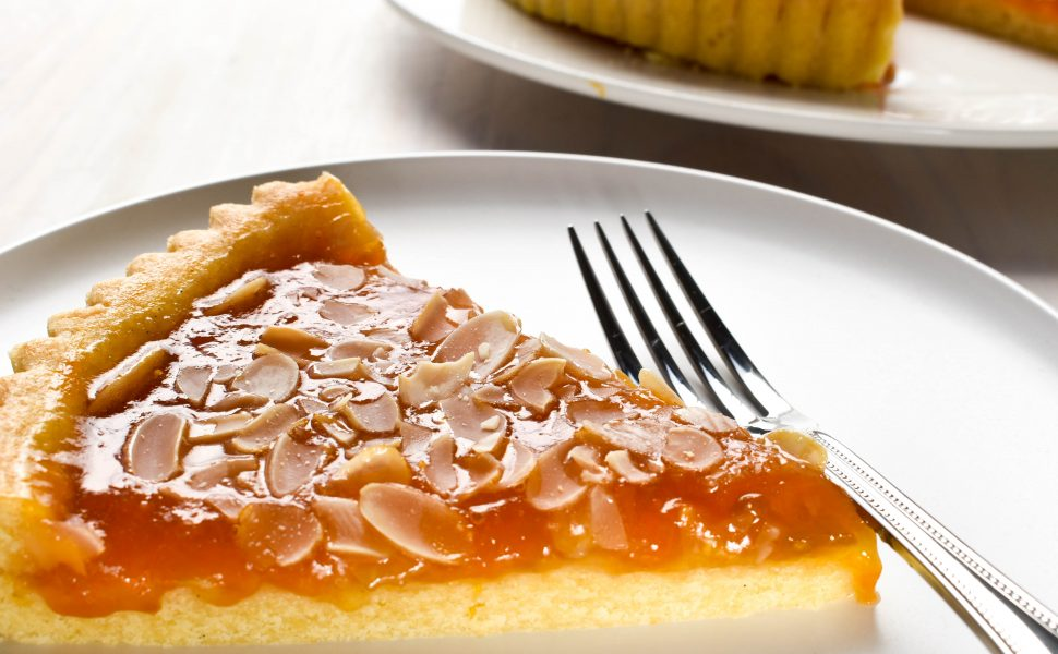 Crostata (tart) of homemade apricot jam and flaked almonds