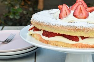 Torta della nonna (Nonna's sponge cake) with strawberries and cream
