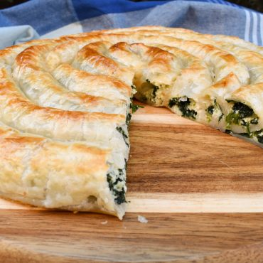 Rolled puff pastry with spinach and ricotta filling