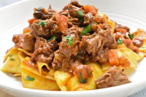 Pappardelle pasta with slow-cooked beef and porcini ragù