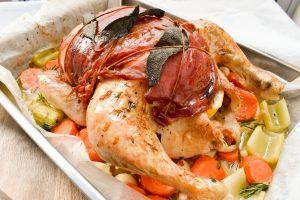 Roast chicken wrapped in sage and prosciutto