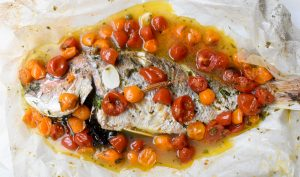 Baked snapper in acqua pazza